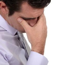 Man feeling workplace stress